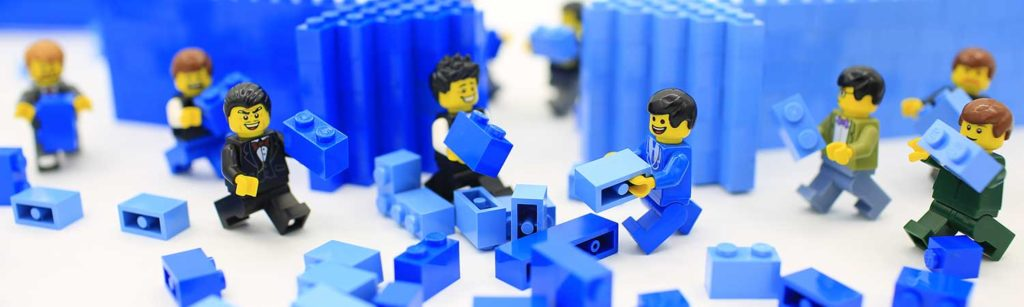 lego characters moving small bits of blue lego