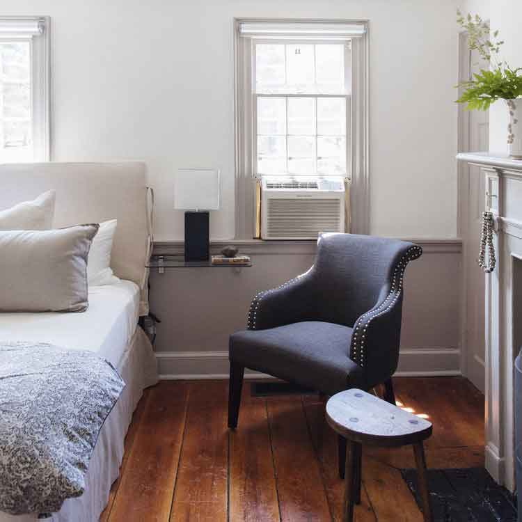 Part of the original Squire Tarbox Inn, The Mittman Room features one king bed, original wood floors, and an en suite bathroom with a walk-in shower. This light and bright space overlooks the inn's charming front lawn and includes a beautiful brick fireplace.
