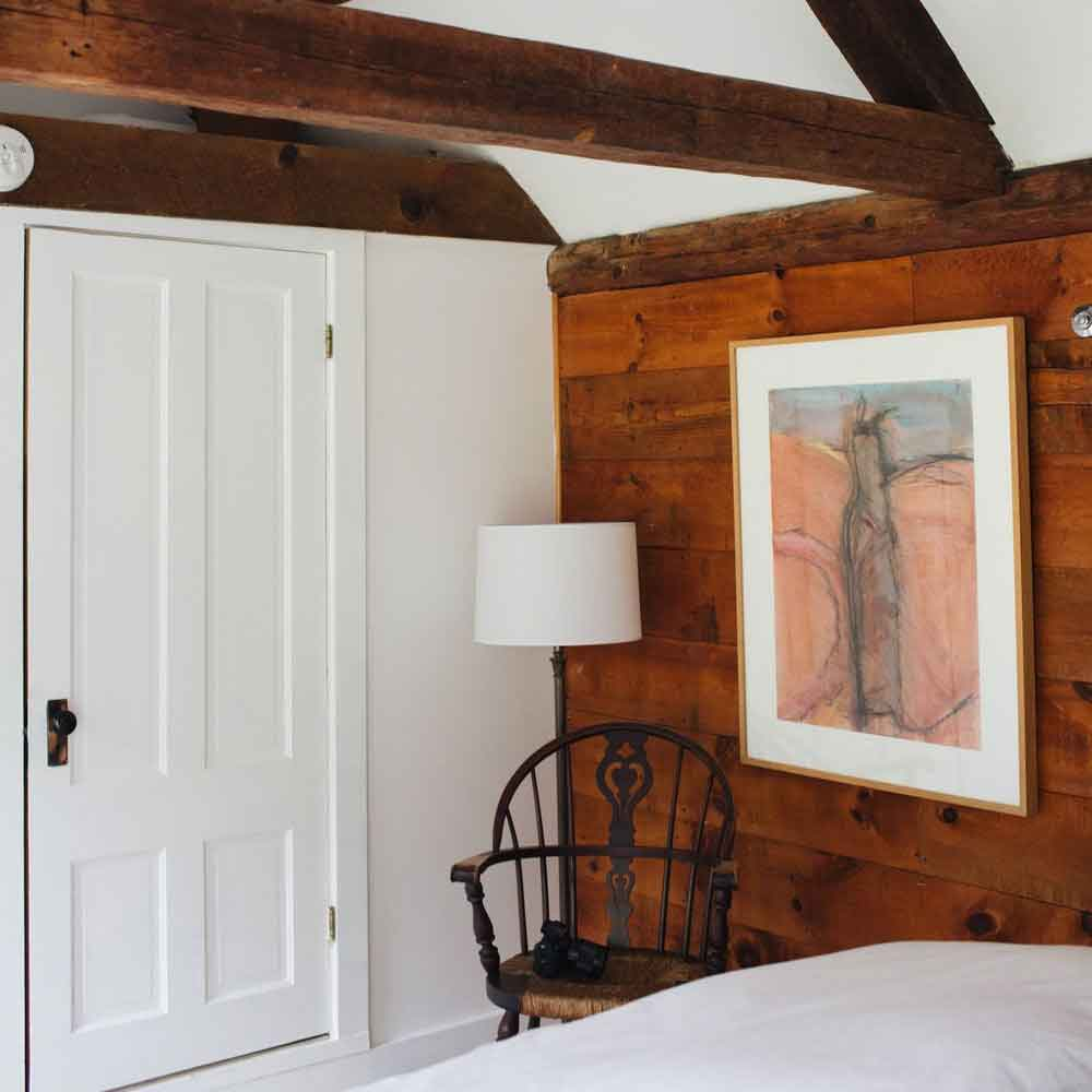 Accessible by a private outdoor entrance, The Eleanor Room is located in the original inn's refurbished barn. Featuring an eye-catching vaulted ceiling, this room is cozy and private with a comfortable queen bed and small en suite bathroom with a walk-in shower.