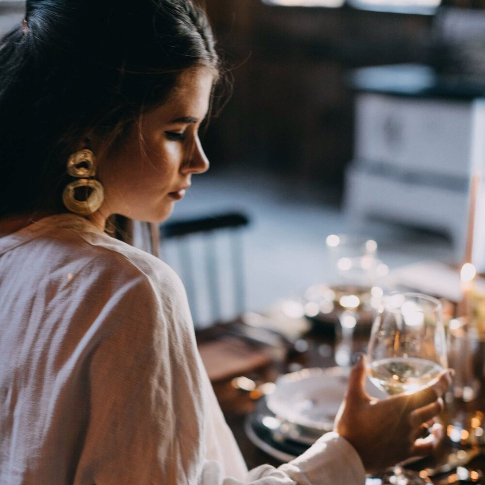 A woman drinking a glass of wine at the Squire Tarbox Inn