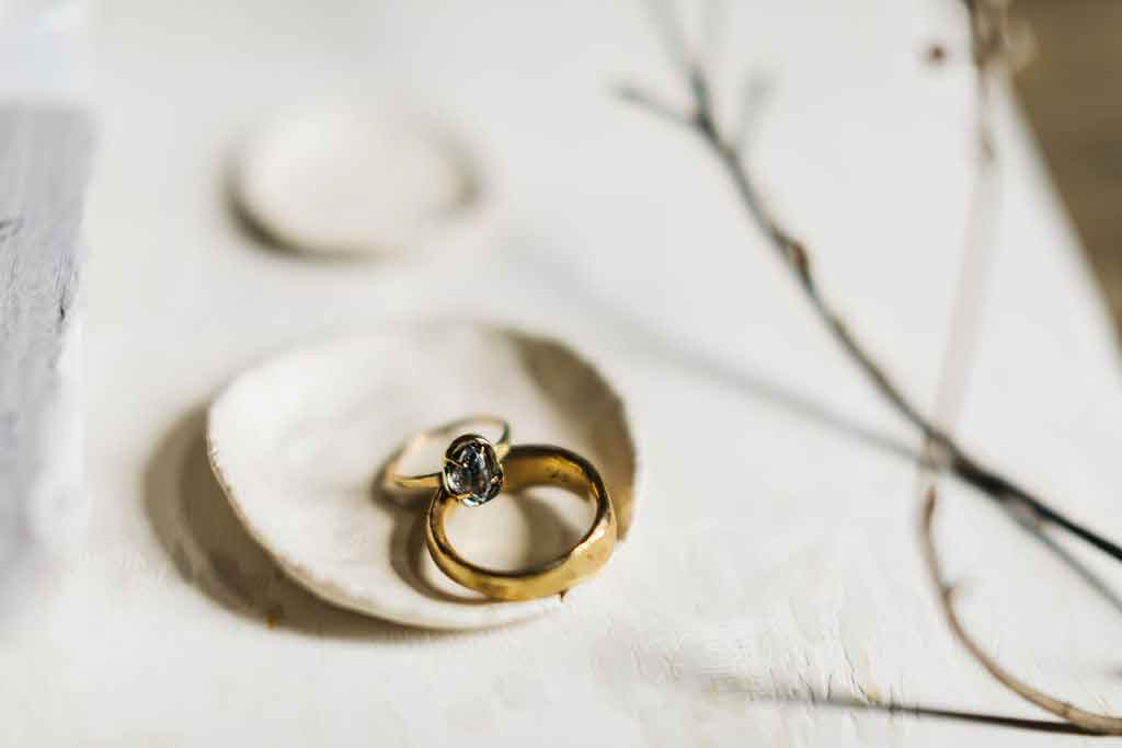 Wedding rings on a table at the Squire Tarbox Inn