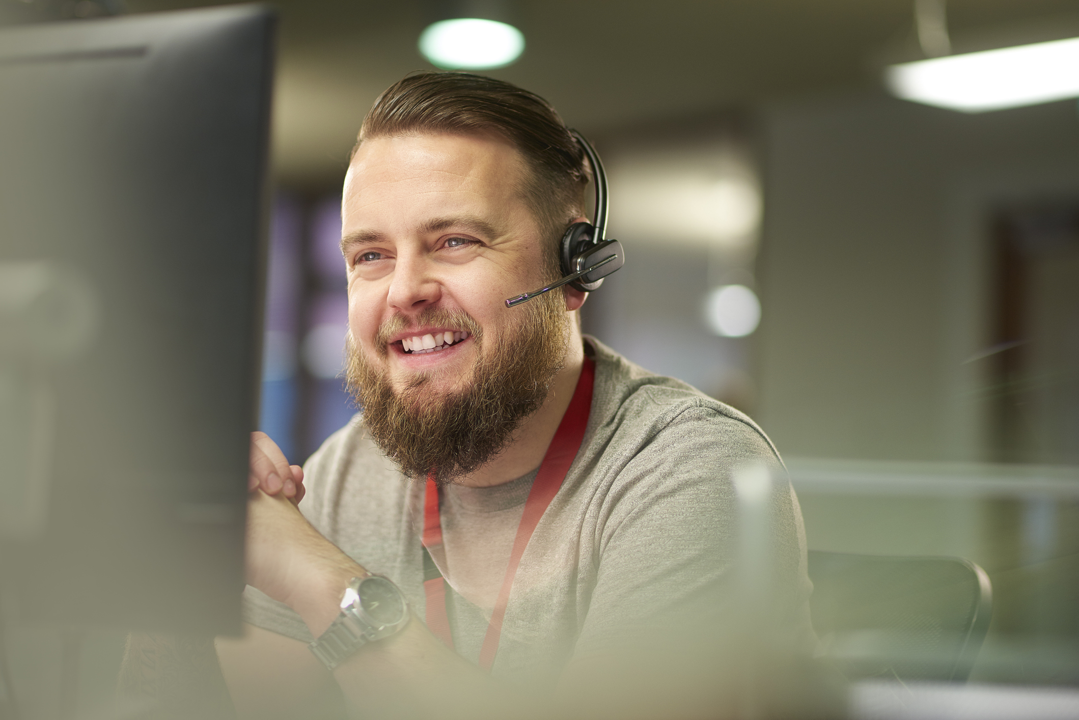 Happy sales person holding a demo or making a call to prospect