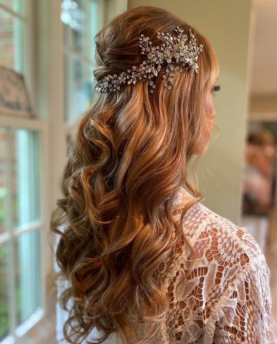 Wavy bridal hair with diamond leaf headpiece