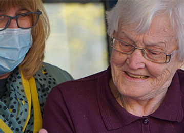 Caregiver looking after an older woman