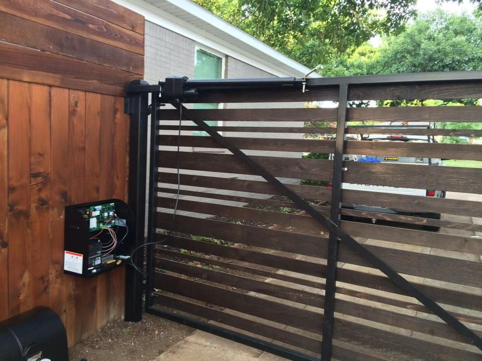 custom gated fence project installed by Green Eagle Door