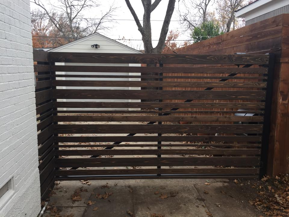electric gate project with metal and wood installed by Green Eagle Garage Door