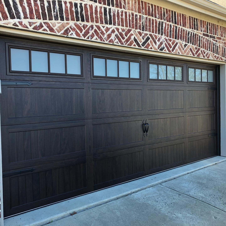 dark painted metal garage door project in Lantana, TX