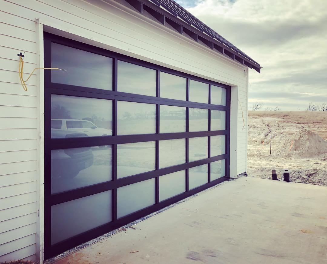 metal garage door with large glass panels