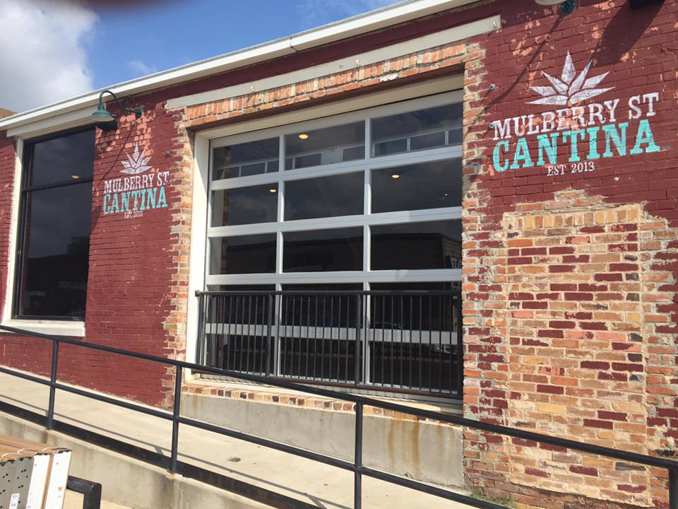 Mulberry Street Cantina metal and glass garage door installation project in Denton, TX