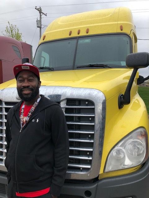 man standing next to a truck