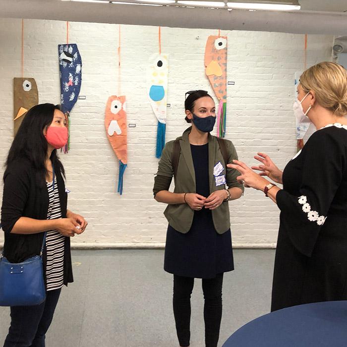 Geneva School parents wearing masks conversing