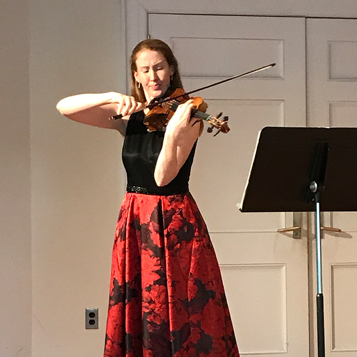Woman playing violin on stage
