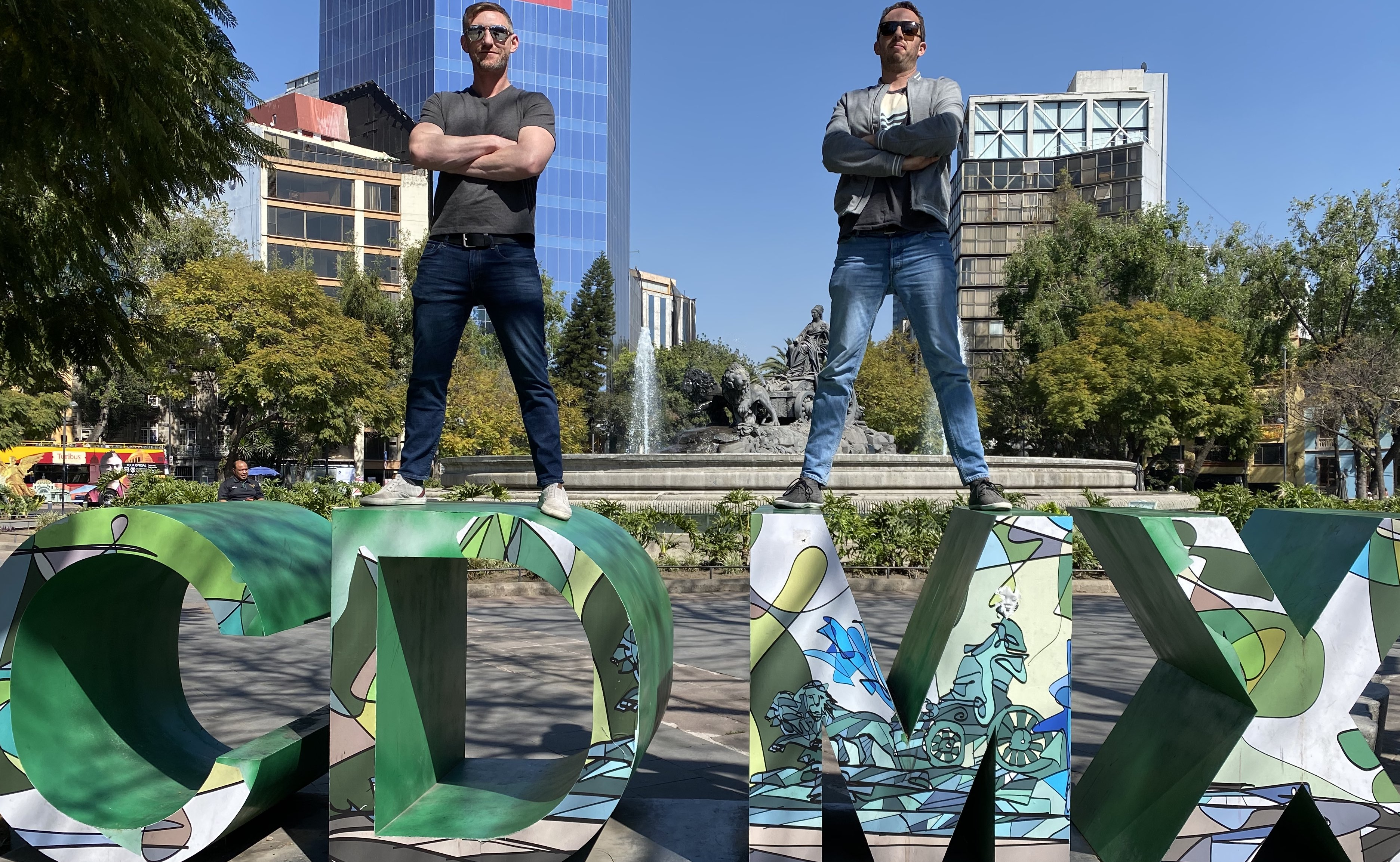 Josh Melick and Travis Pollock standing on CDMX sign in Mexico City