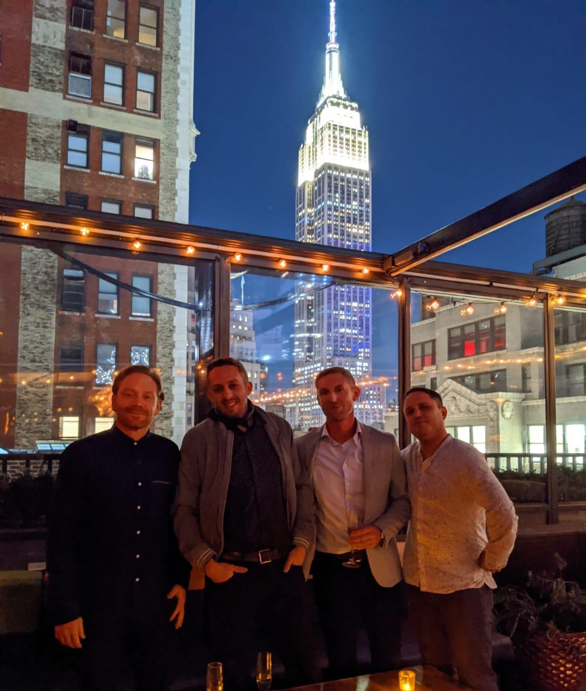 Josh Melick and friends standing in front of Empire State building
