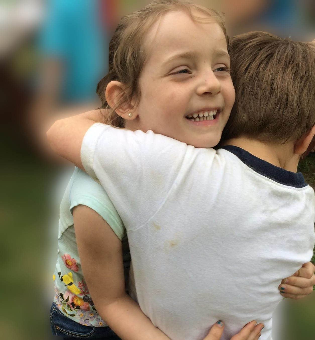 Preschool children hugging