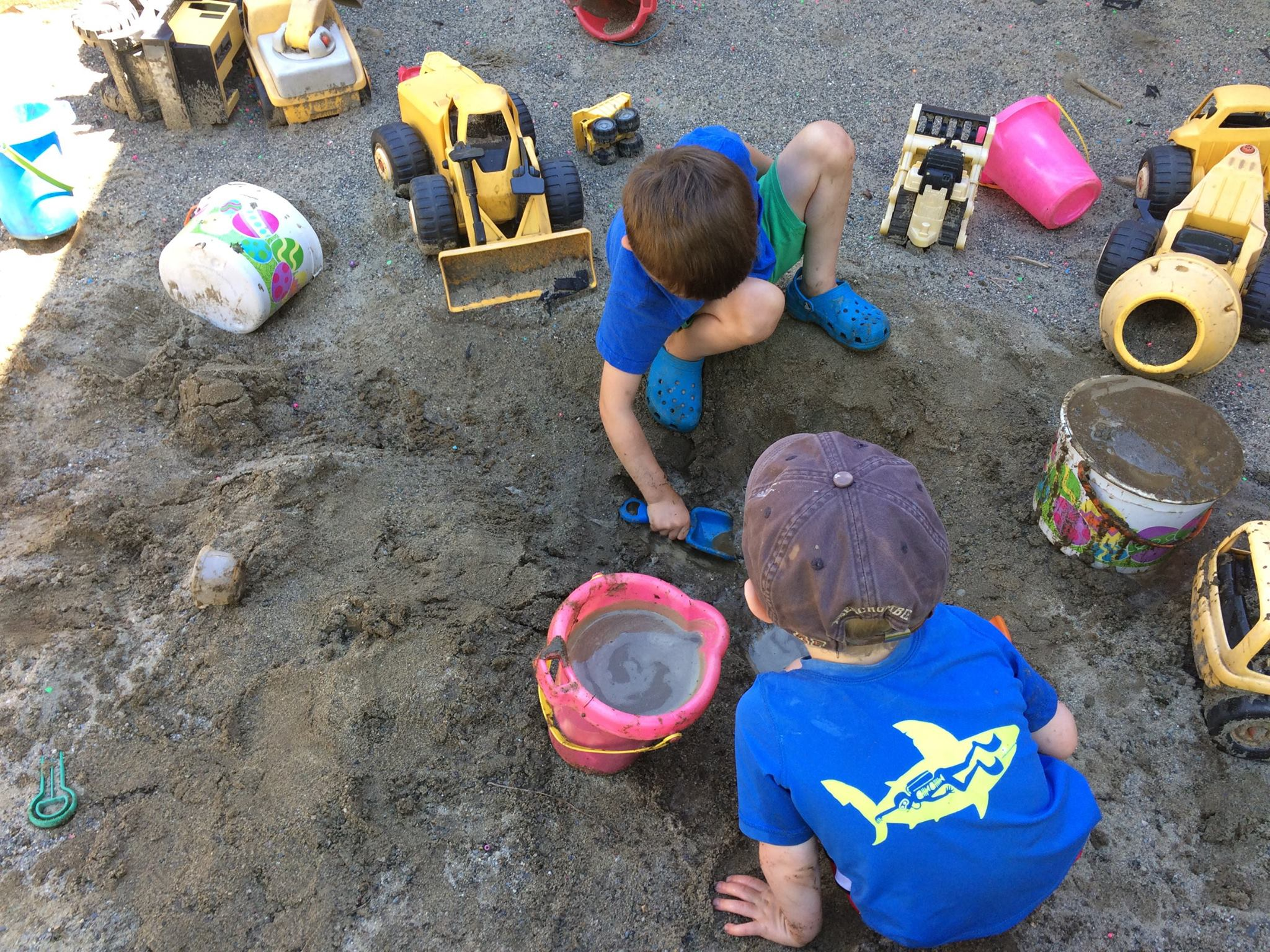 preschool children playing in sandbox