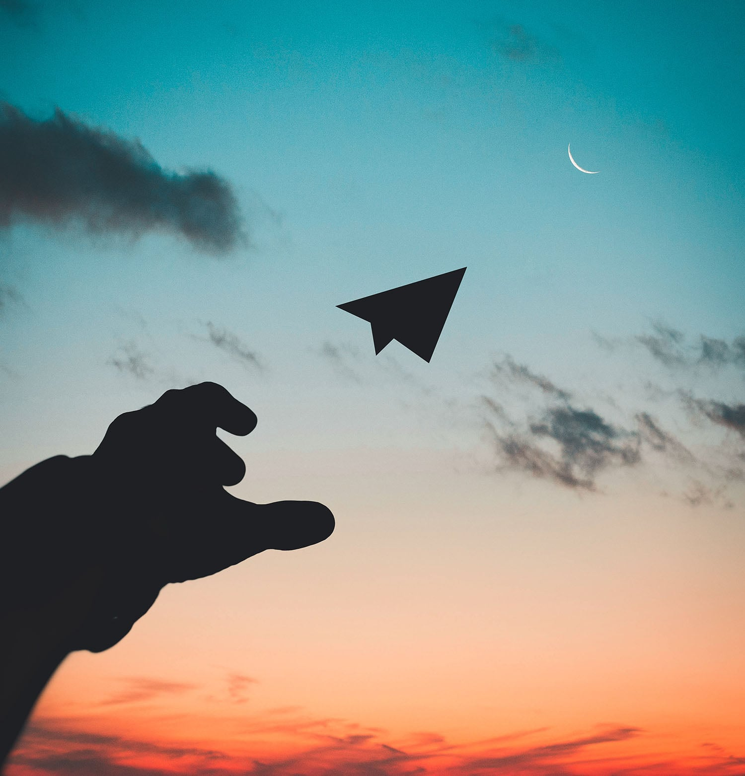 hand throwing a paper airplane