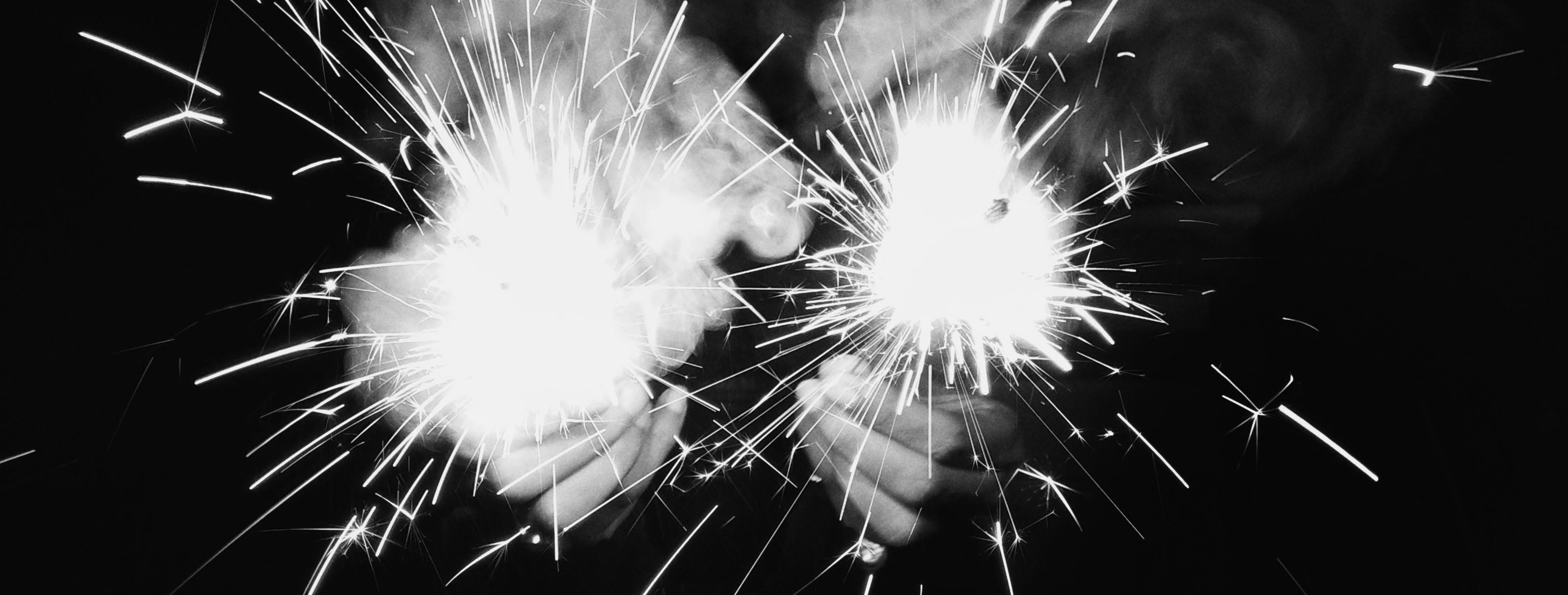 a person holding sparklers