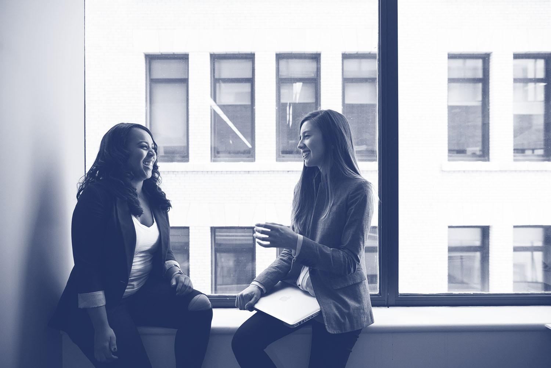two women talking at work