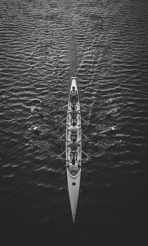 group of people rowing
