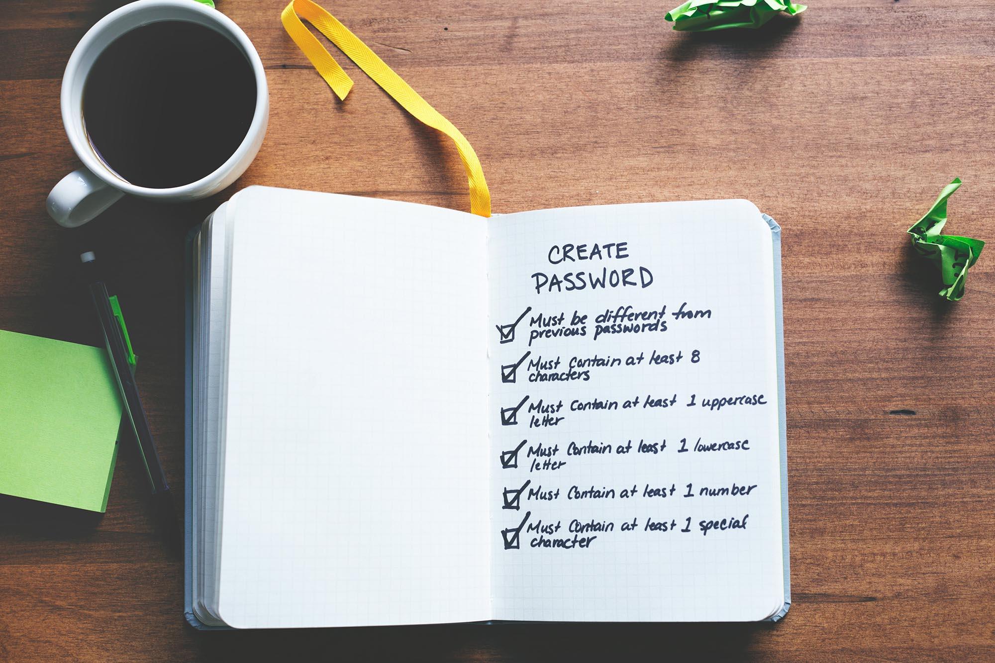 a notebook with password criteria checklist