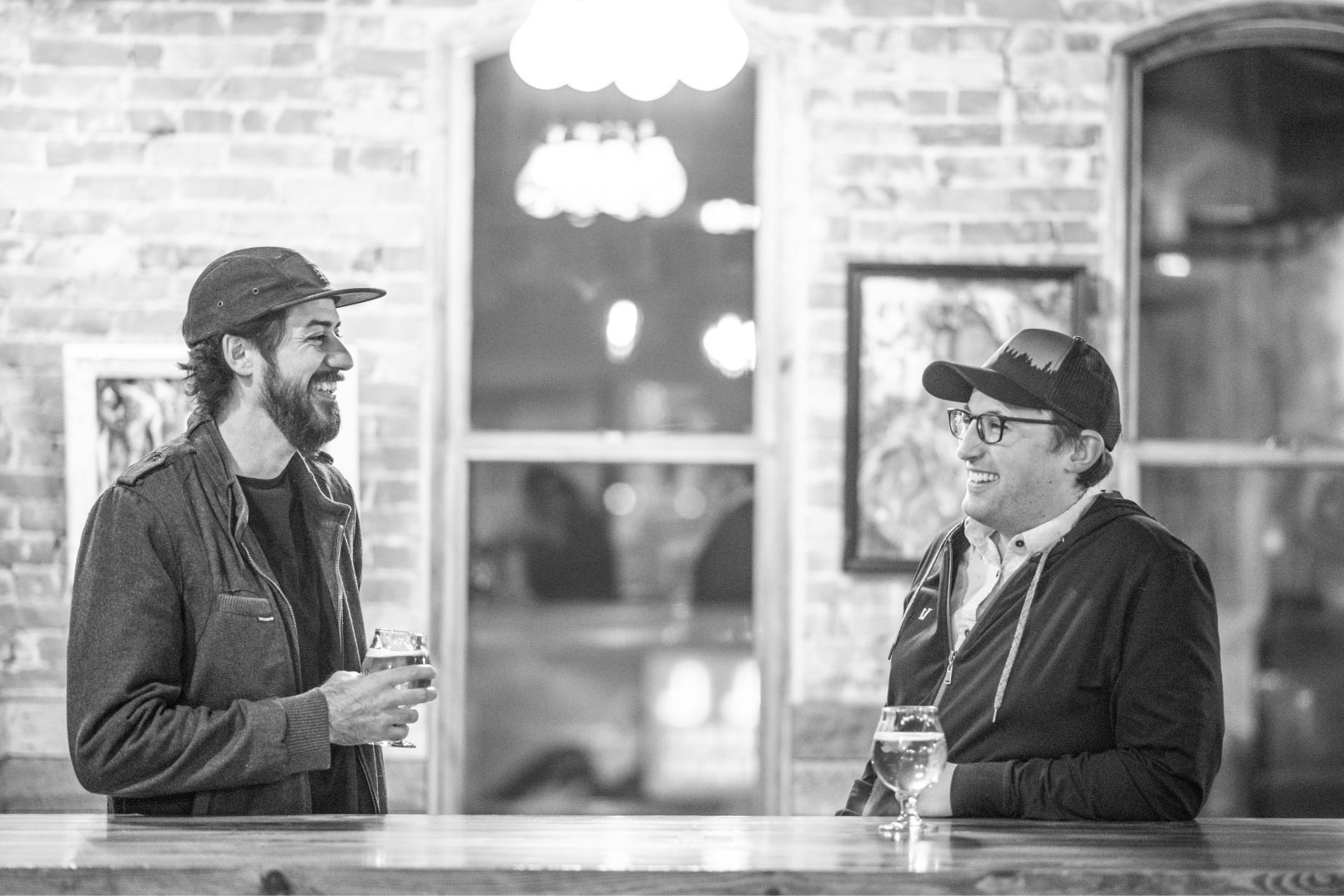 Adam and Danny enjoying a beer and giggling at bad puns inside Odell Taproom in Denver.
