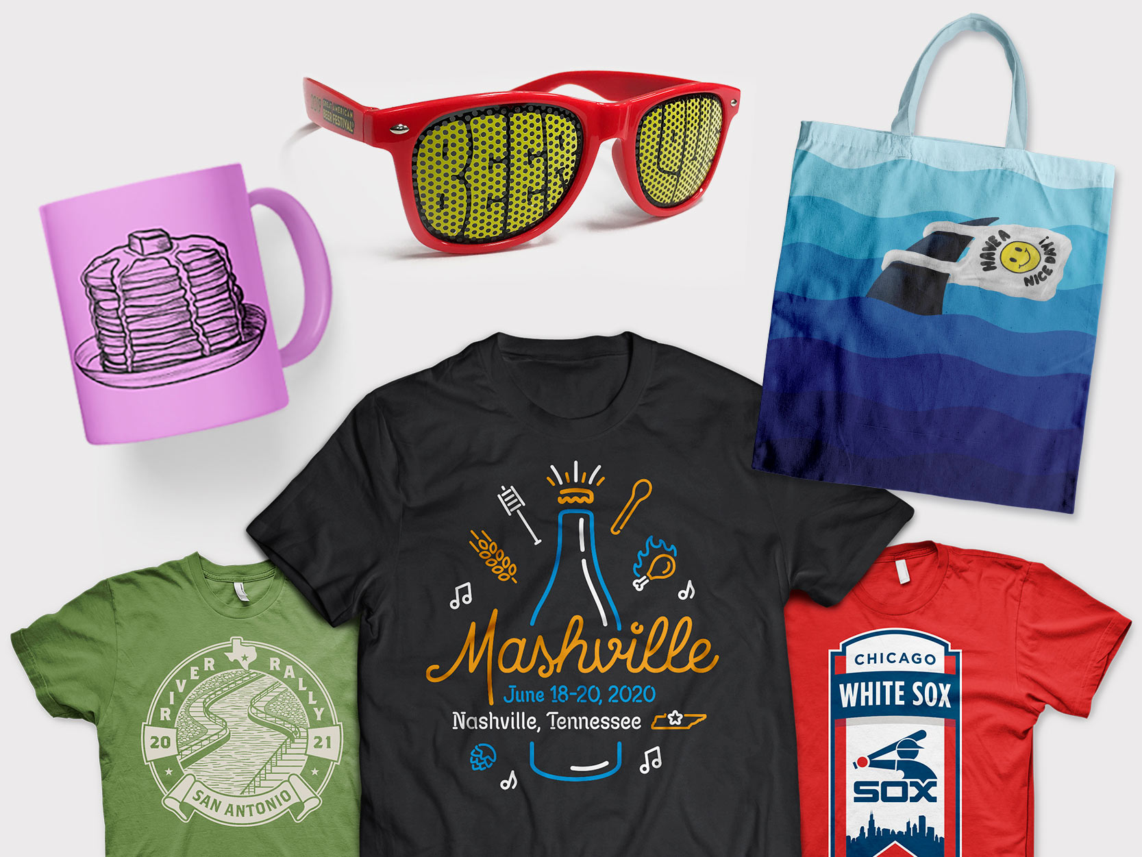 """A collage of merchandise examples including a pink coffee mug with an illustration of pancakes on it, red sunglasses with the words """"Beer Love"""" on the lenses, 3 t-shirts with various graphics on them and a tote bag with an illustration of a shark's fin carrying a plastic bag that reads, """"Have a nice day!""""."""