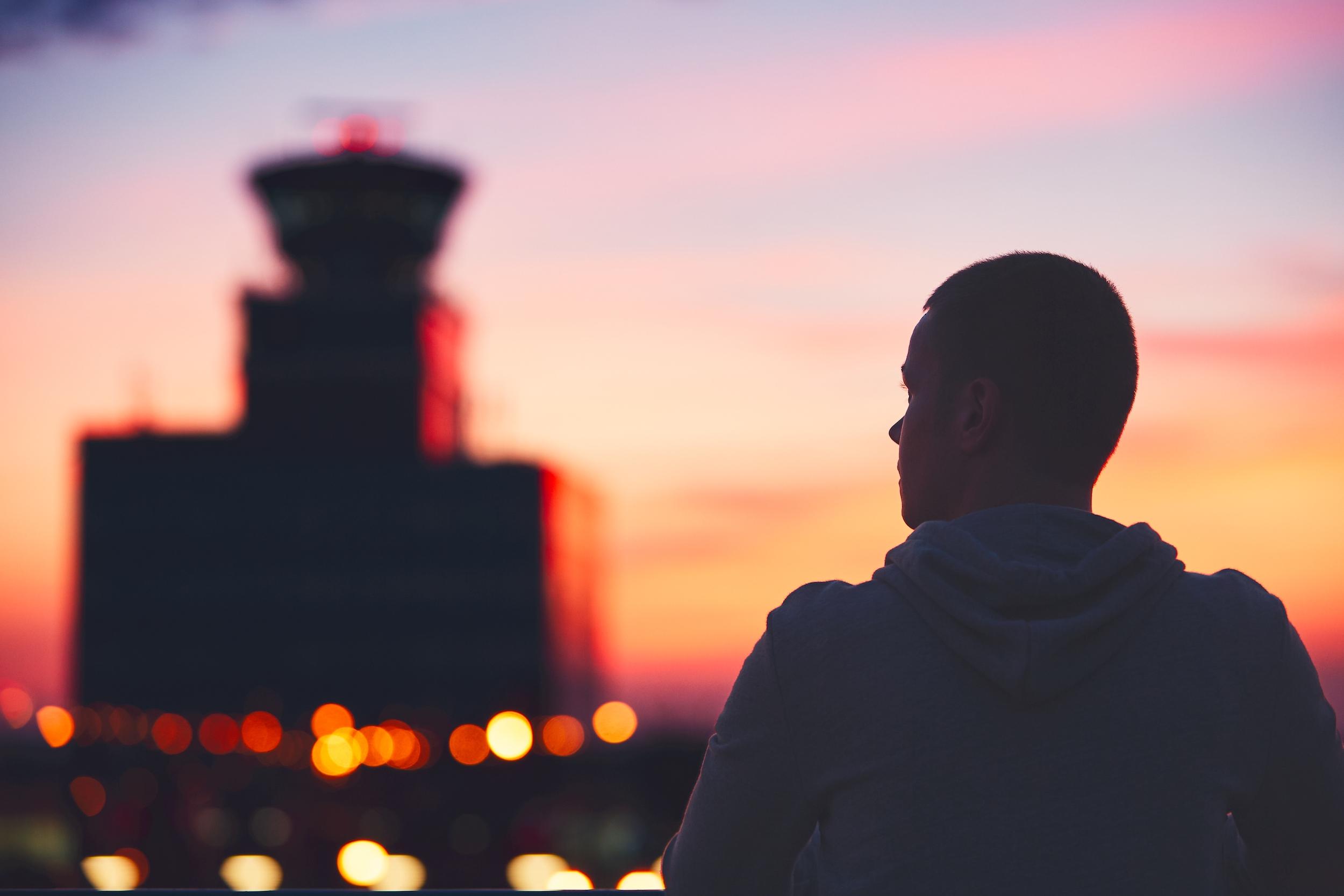 Man looking at air traffic control tower