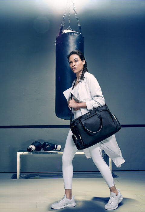 A portrait of Rosario Dawson dressed as a boxer
