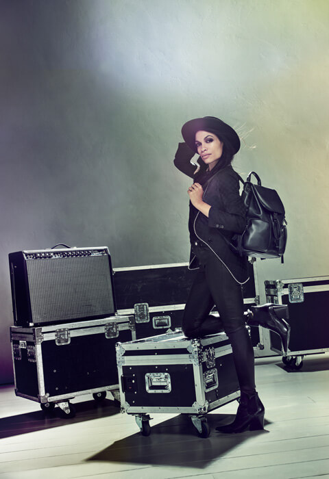 A portrait of Rosario Dawson dressed as a rockstar