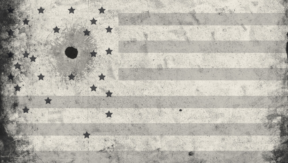 The american flag with the stars falling off around a bullet hole