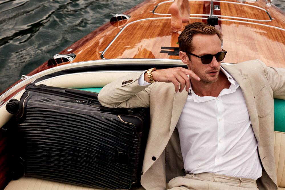 Alexander Skarsgard sitting in a boat