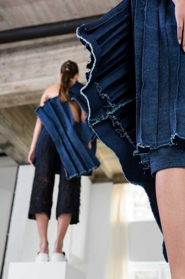 Frog perspective on jeans dress with insight into the inner life of the dress especially fringes and three dimensionality