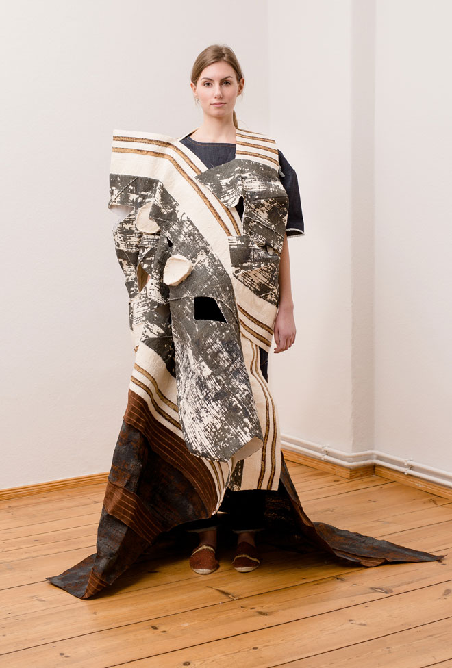 Textile art object on man consisting of a patchwork of fabrics made of sprinted and quilted bark - front view