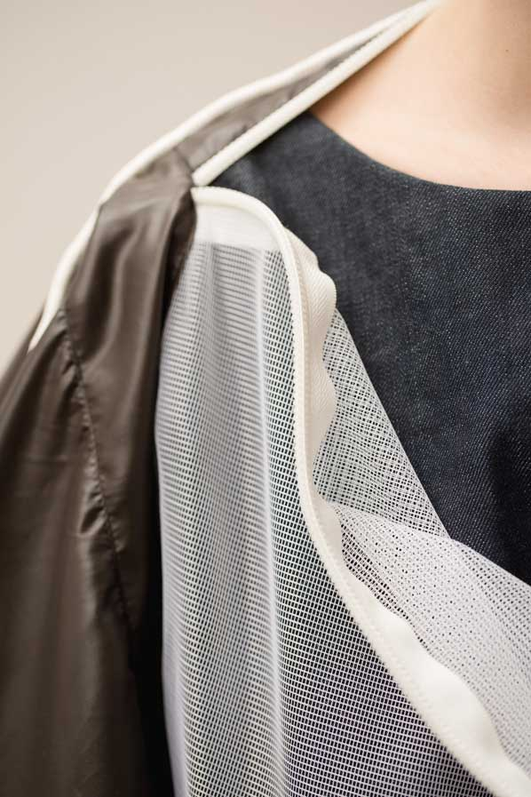 Detail shot of top silhouette front with white mosquito net over dark denim