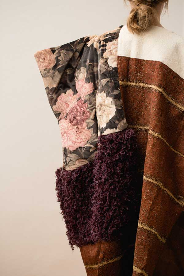 Back view of fashion artwork with purple knit, quilted velvet and brown bark