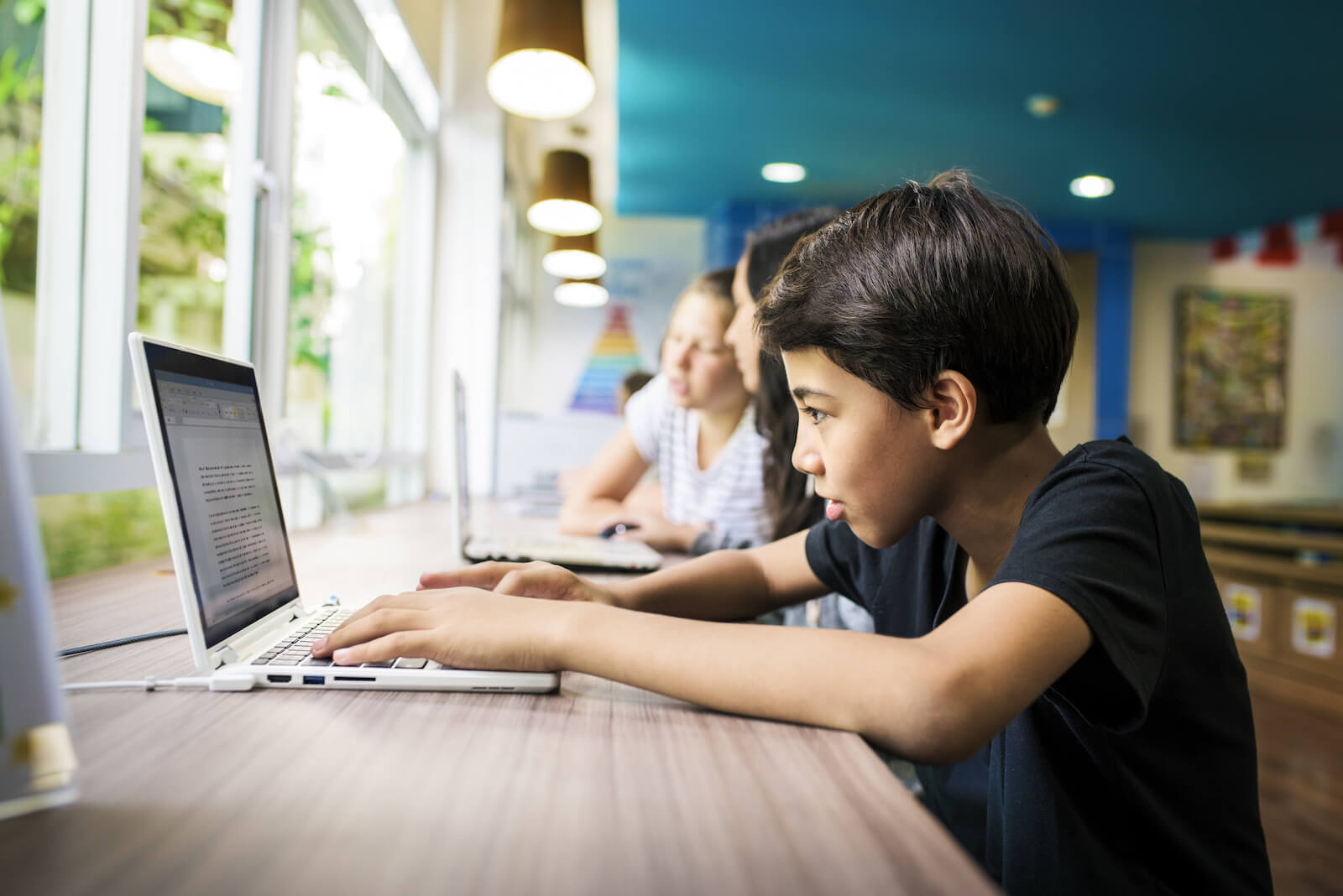 NLP in education: young students using laptops