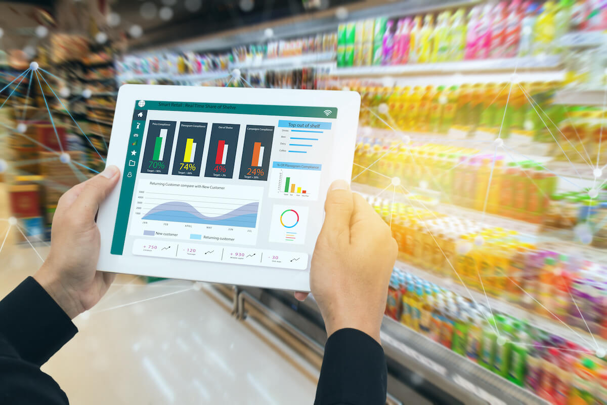 Product recognition: person holding a tablet inside a grocery store