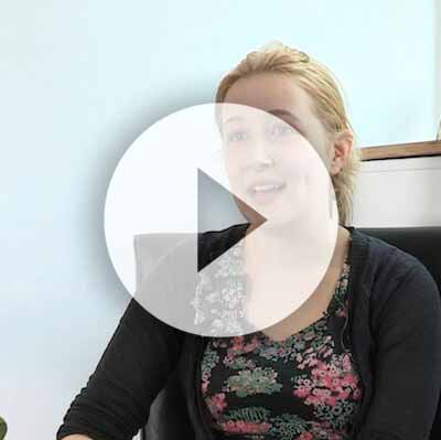The Therapy Lounge - Happy female customer sitting on chair - London Hypnotherapy, NLP & CBT