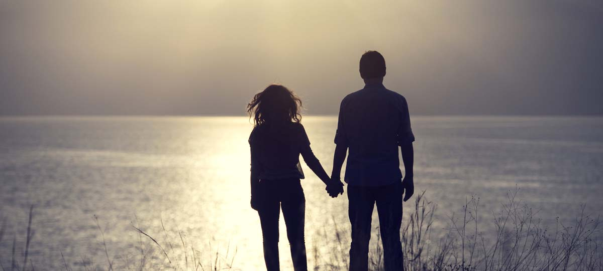 The Therapy Lounge - Happy couple holding hands improving relationship - London Hypnotherapy, NLP & CBT