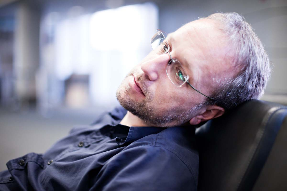 The Therapy Lounge - Stressed man sitting on chair - London Hypnotherapy, NLP & CBT