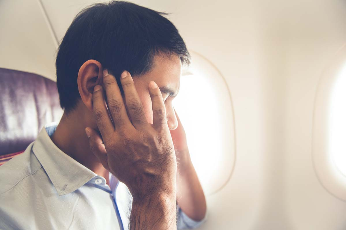 The Therapy Lounge - scared man on plane phobia of flying - London Hypnotherapy, NLP & CBT