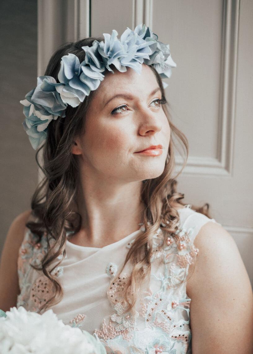 A bride wearing a flower crown.