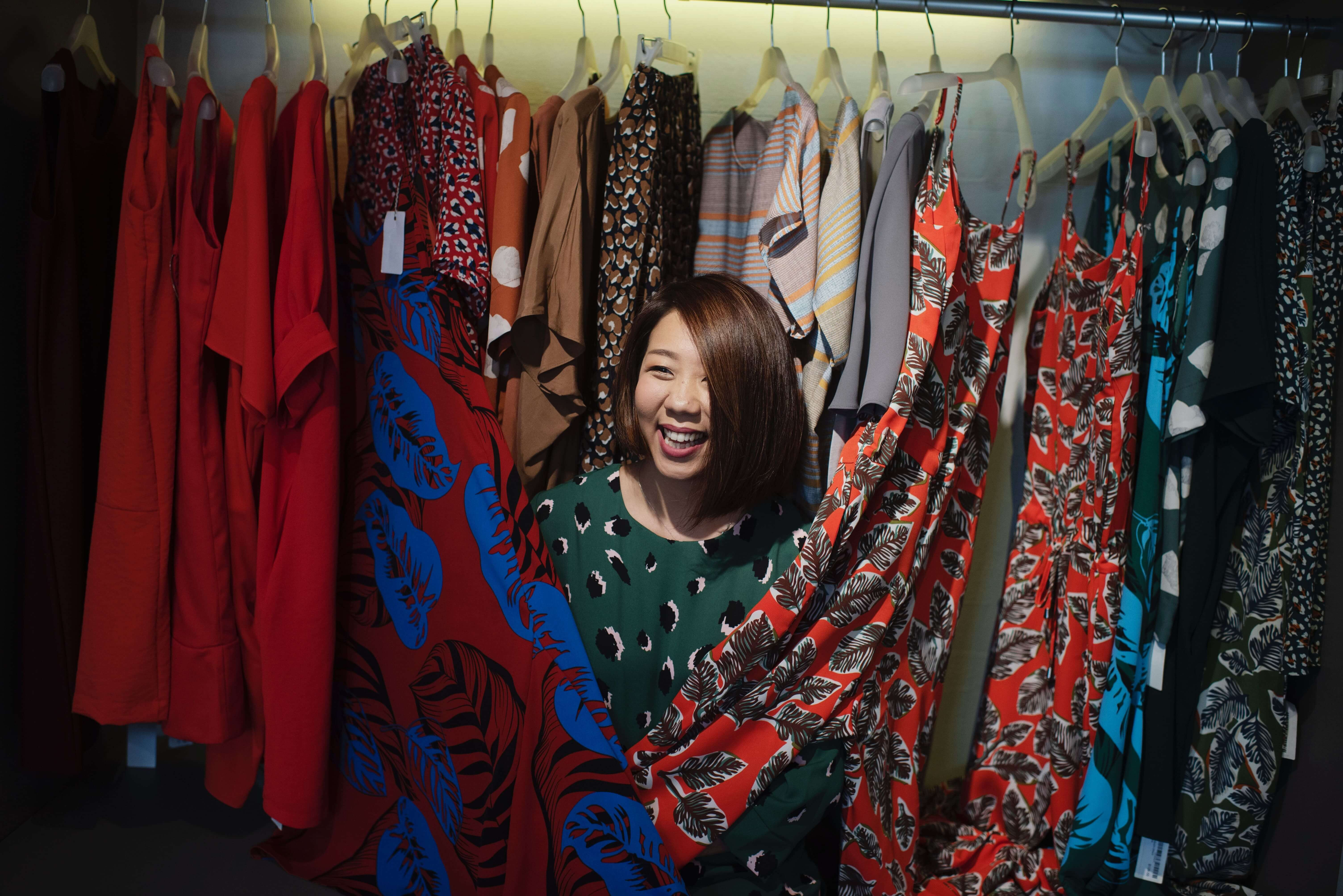 An entrepreneur in her small business shop passionate about her crafted clothes