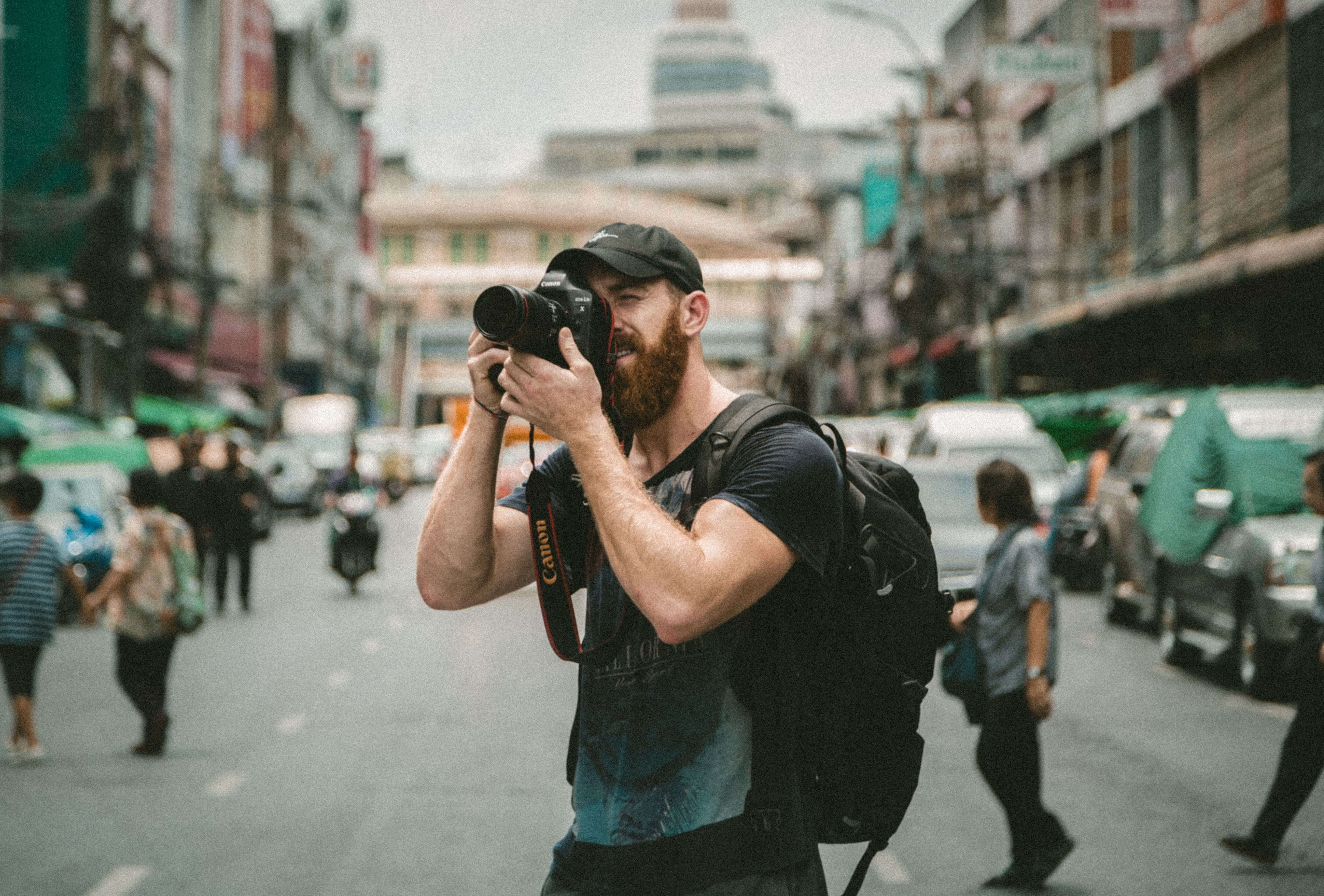 A freelance LLC photographer capturing his needs in a city