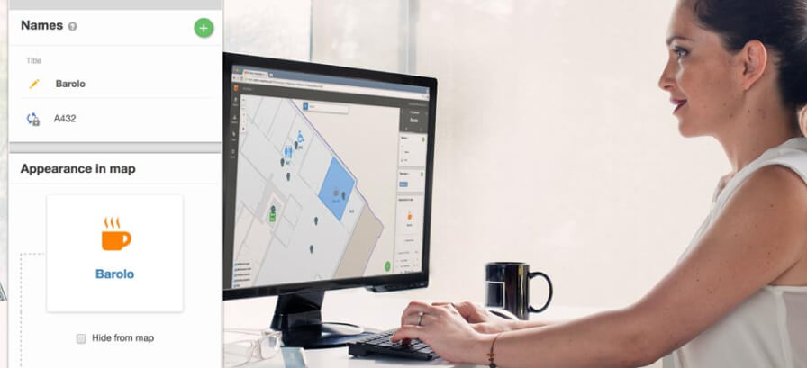 Woman working on our Map Editor on her computer