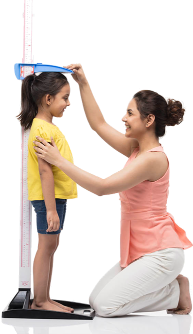 Mother measuring her daughter height growth