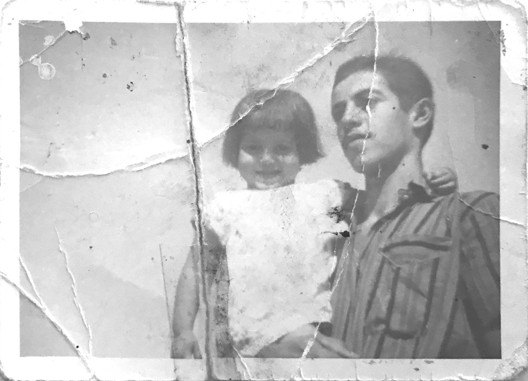 An image of a child being held by a man in 1969 as submitted to the Iraq Photo Archive.