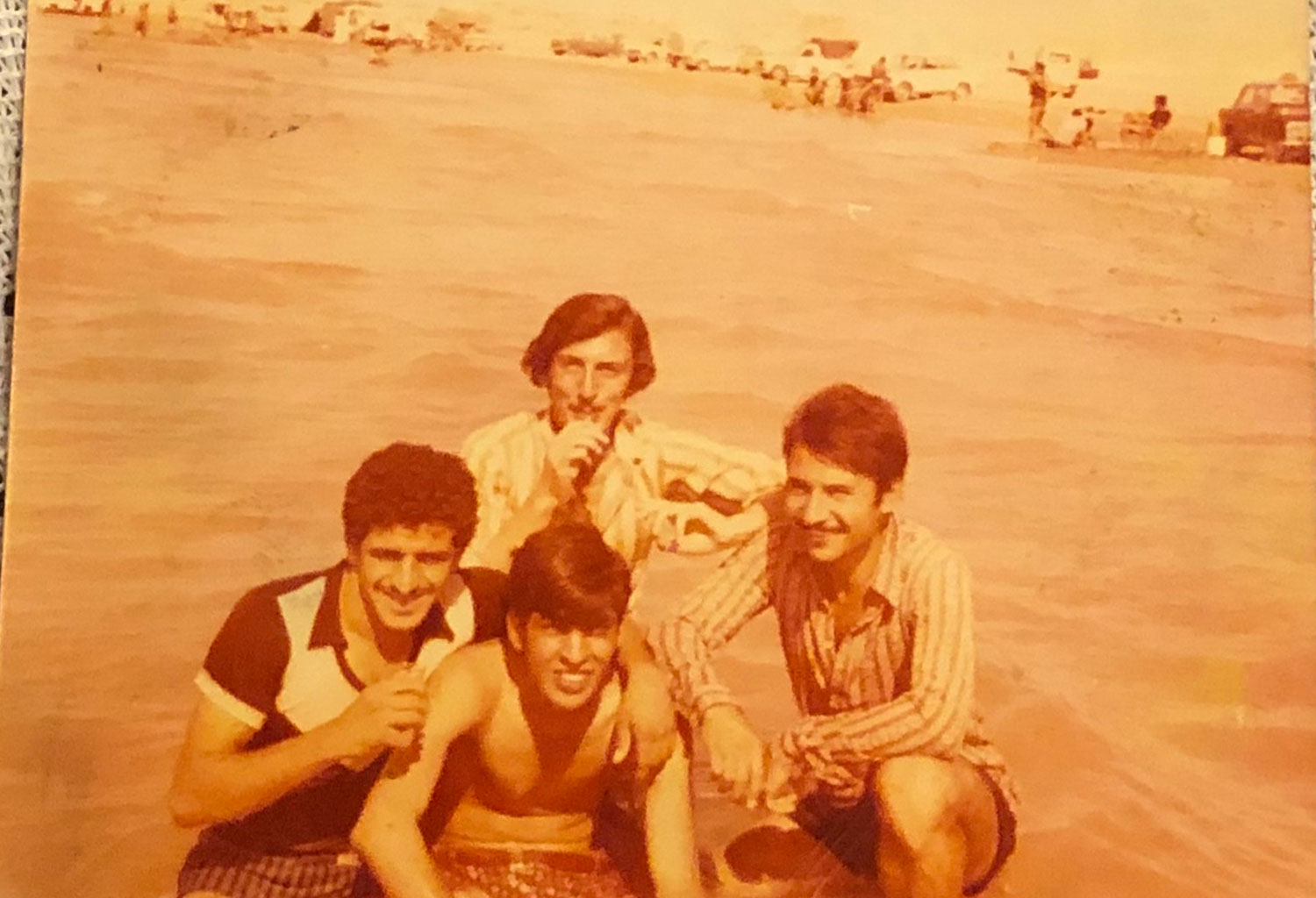 An image of four men posing during trip to Al Habbaniyah Lake in the 1970s as submitted to the Iraq Photo Archive.