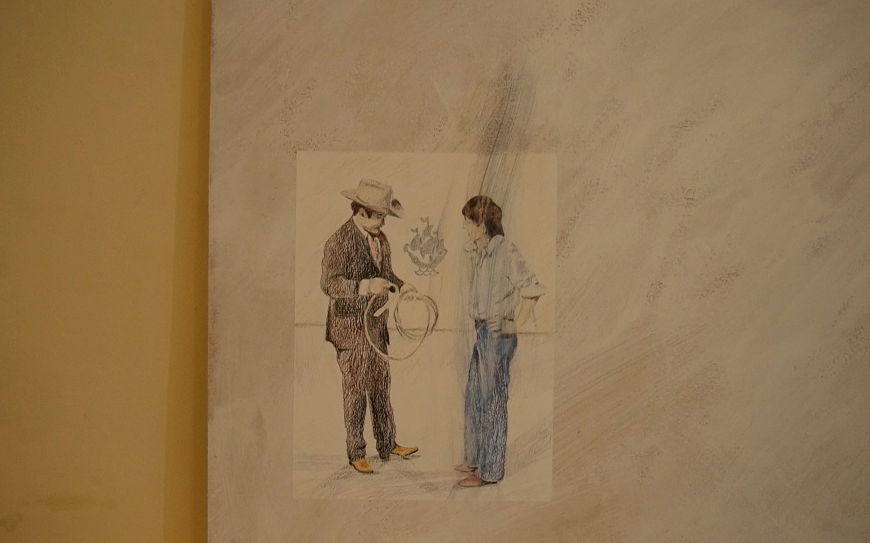 A cowboy is drawn facing another man. The cowboy is holding a rope. The blue Peter logo is in the background.